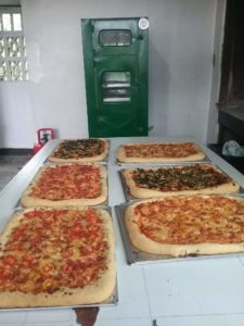 With our custom-made oven,, we baked all of these pizzas at one time!