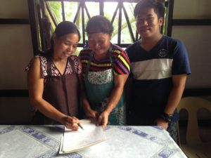 The mothers are signing for their first paycheck!! To God be the glory!!!
